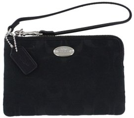 What's in Our Pool Bag. Coach Signature Black Wristlet Wallet